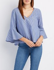 This top is perfect for the ladies who want the drama of a bell sleeve without wanting to have their shoulders out. This woven top is a cool $21.99 from Charlotte Russe to match the cool blue color.