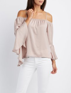 "This top has both the ""it"" color of the season and the statement sleeve that we'll be talking about next! You can't go wrong with the best of both worlds!"